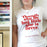 Feminist T Shirt 'Though She Be But Little She Is Fierce' in Red and White.