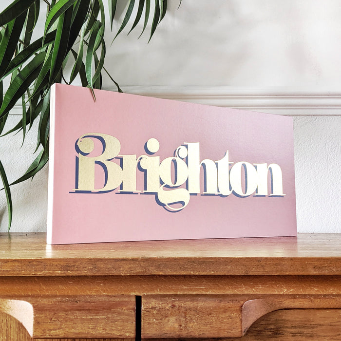circus style gold leaf inspired personalised location sign on a wooden ply block.