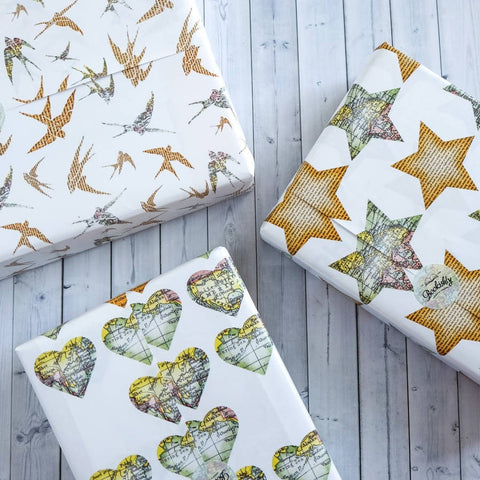 Pack Of Four Wrapping Sheets - Map / Star / Swallow / Heart Design
