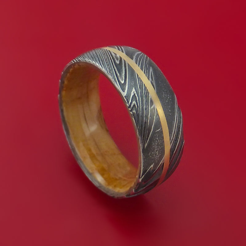 Kuro Damascus Steel Ring with 14K Yellow Gold Inlay and Jack Daniels Whiskey Barrel Wood Hardwood Sleeve Custom Made Wood Band