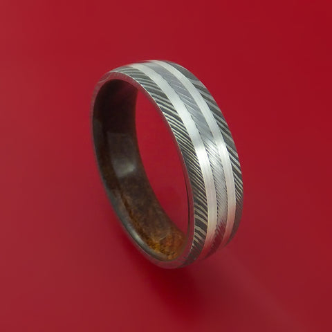 Damascus Steel Ring with Silver Inlays and Kauri Hard Wood Sleeve