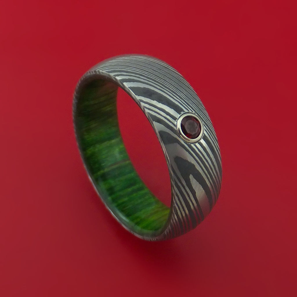 Damascus Steel Ring with Round Brilliant Garnet Stone and Jade Hardwood Sleeve Custom Made