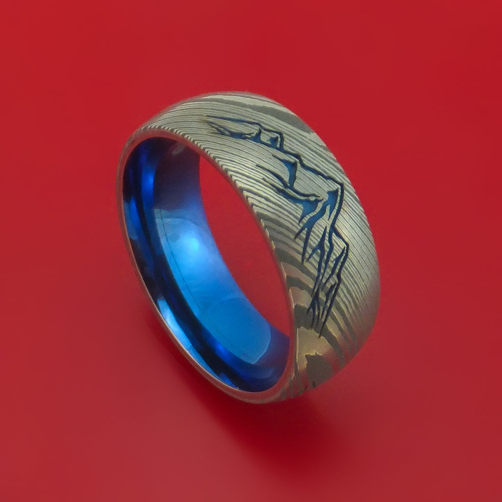 Damascus Steel Ring with Laser-Etched Mountain Pattern and Cerakote Inlays and Interior Anodized Titanium Sleeve Custom Made Band