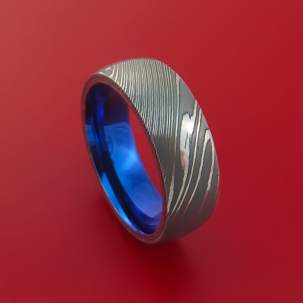 bold color damascus steel wedding bands Damascus Steel Ring with Anodized Titanium Interior Sleeve Custom Made