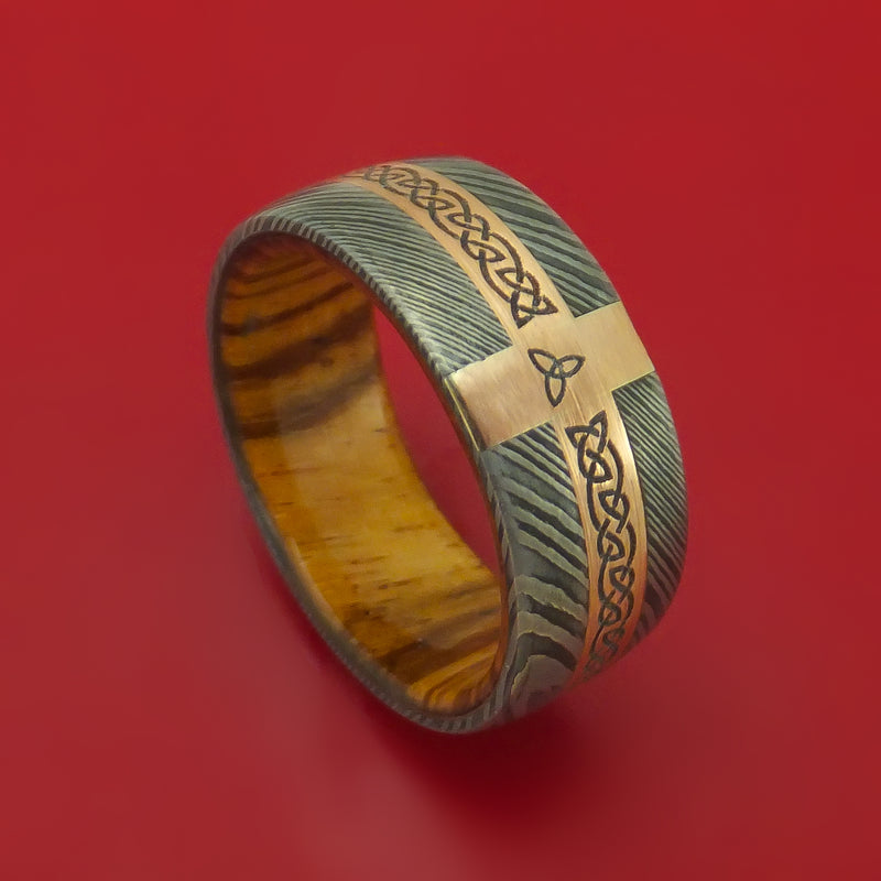 Damascus Steel Ring with 14k Rose Gold and Etched Celtic Design Inlays and Interior Hardwood Sleeve Custom Made Band