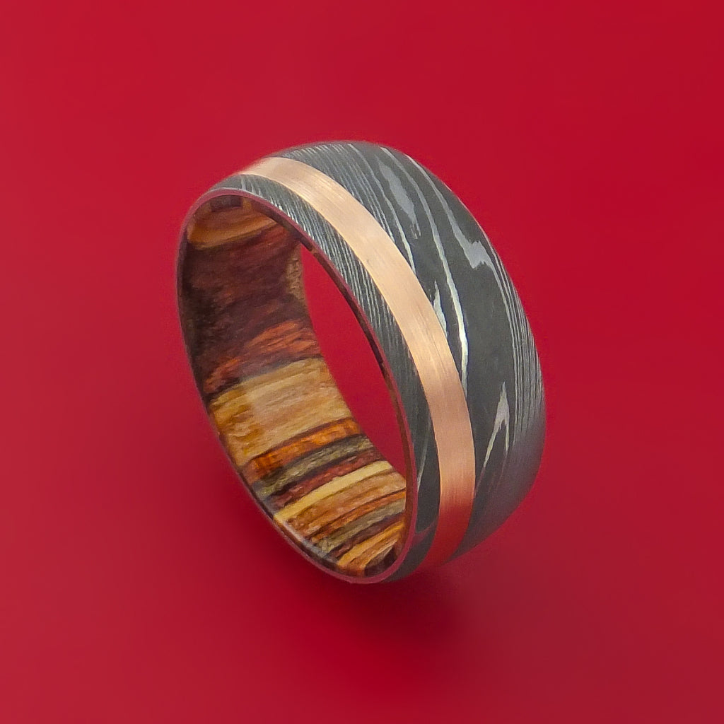 Damascus Steel Ring with 14k Rose Gold Inlay and Interior Hardwood Sleeve Custom Made Band