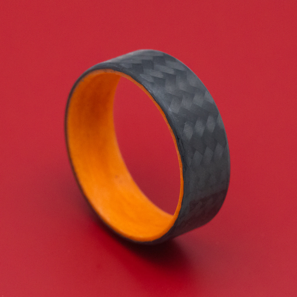 Carbon Fiber Ring with Orange Glow Sleeve