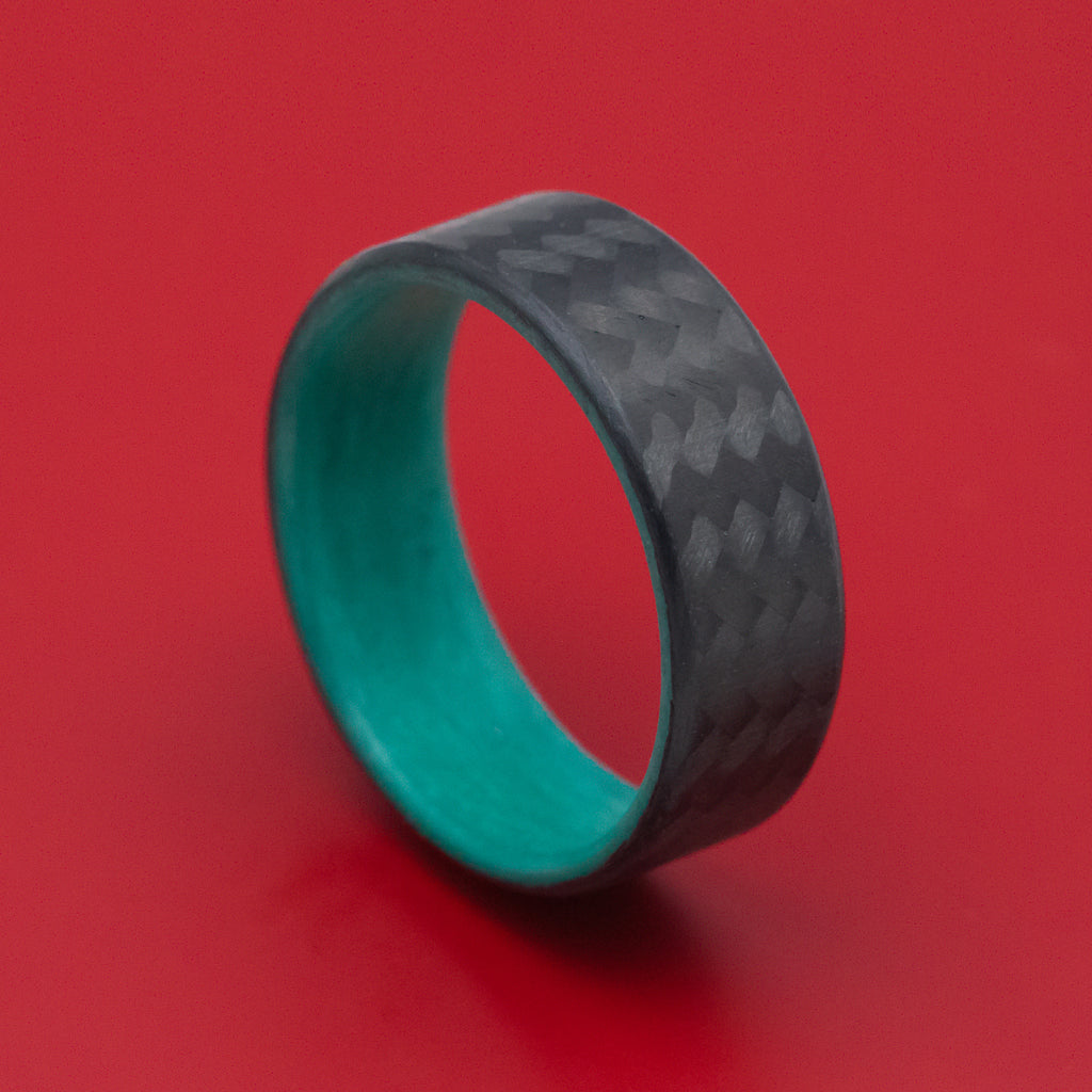 Carbon Fiber Ring with Teal Glow Sleeve
