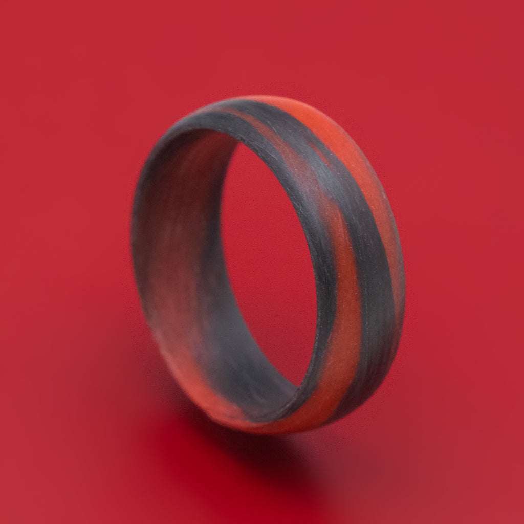 Carbon Fiber Ring with Red Glow Marbled Design