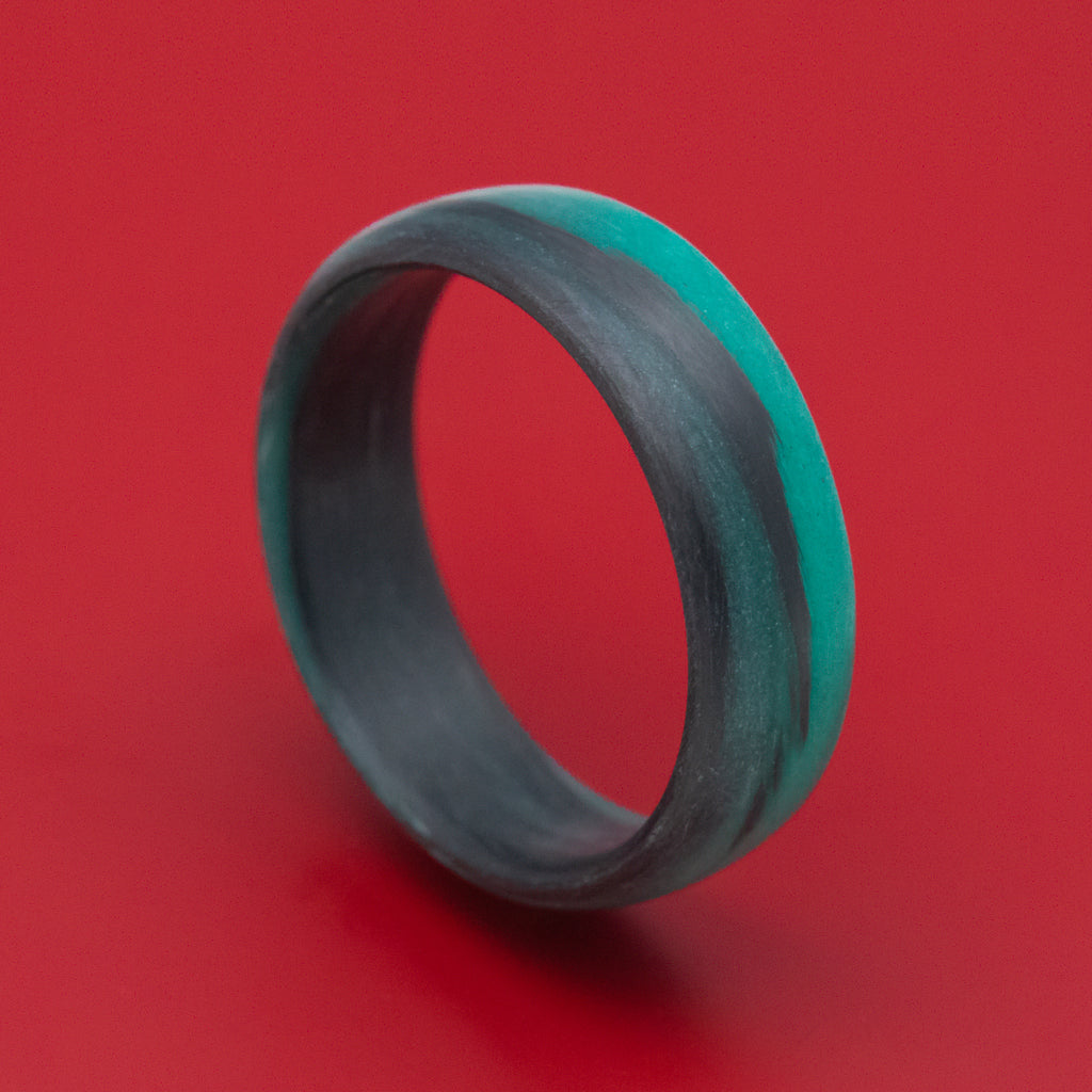 Carbon Fiber Ring with Teal Glow Marbled Design