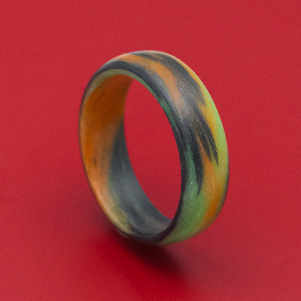 Carbon Fiber Ring with Orange and Green Glow Marbled Design