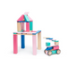 Tegu Toys 24 piece magnetic block set in Blossom set up to look like a house on stilts with a small car beside it