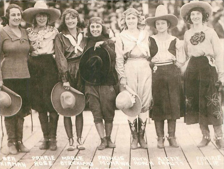 vintage cowgirls smiling at the camera