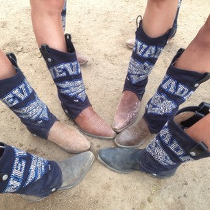 cowgirl boots in a circle, all with UNR cowboy boot covers