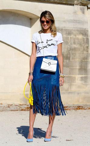 woman wearing blue fringed skirt