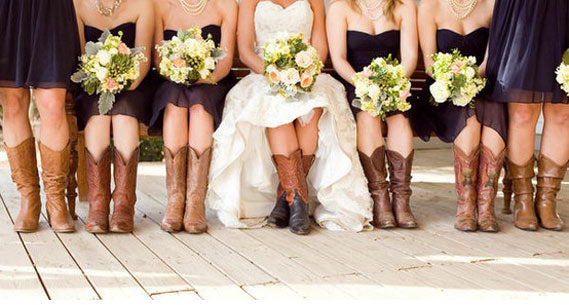 Bride with cowgirl boots with bridesmaids wearing cowboy boots all sitting down