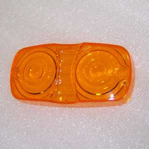 Amber plastic lens for double bubble incandescent marker light
