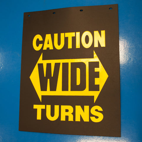 "Caution Wide Turn 24"" x 30"" black poly mudflap w/yellow logo"