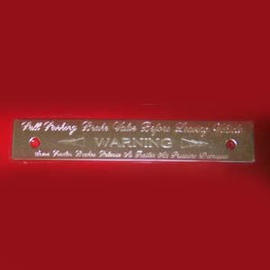 Woody's Peterbilt -2005 stainless steel parking brake statement plate