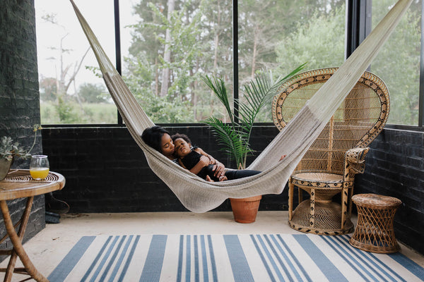 Image of mom and child in a hammock.