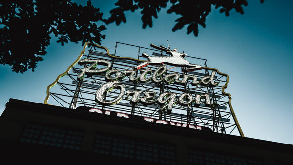 photo of a portland marquee sign on a building against the blue sky