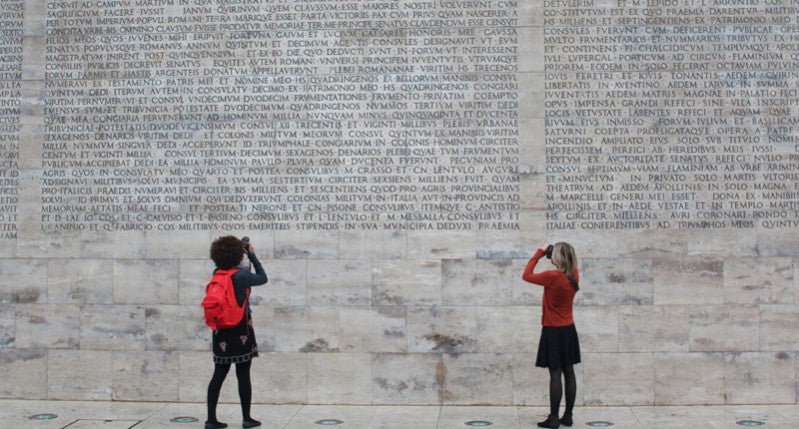 Reham Ibrahim and Sophie photographing the ancient inscription at the Museo dell'Ara Pacis