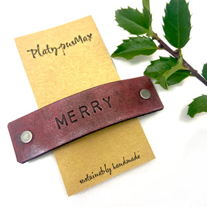 MERRY Red Stamped Leather Holiday Barrette - Platypus Max