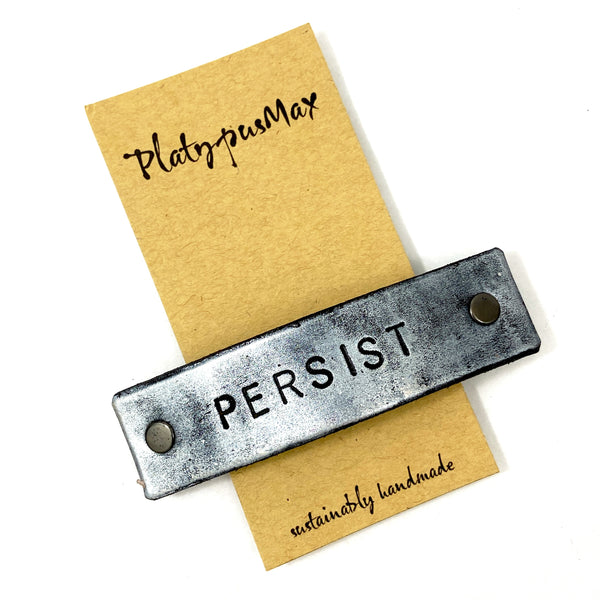PERSIST Stamped Leather Barrette