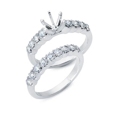 Solitaire Engagement Ring with Shared Prong Set Diamonds and Matching Wedding Band