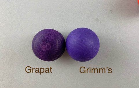 Wooden marbles comparison. Grapat marbles and Grimm's marbles.