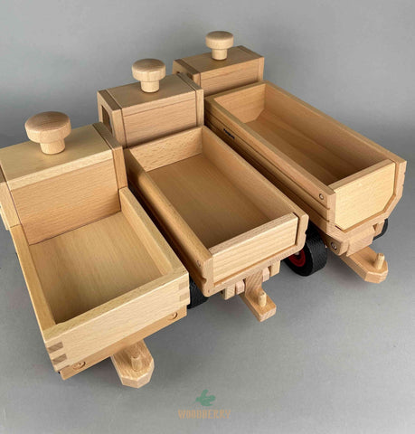 Fagus wooden toys. Unimog and dump truck and container tipper truck
