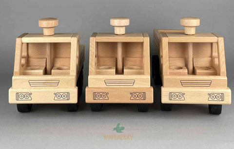 Fagus wooden toys from Germany. Truck comparison. Front view. Unimog/dump truck/container tipper truck