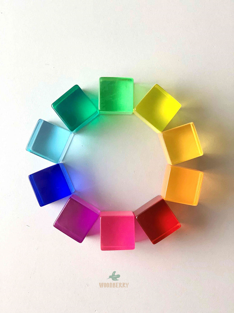 colors of bauspiel lucite cubes, lucent cubes. total of 10 colors arranged in a circle.