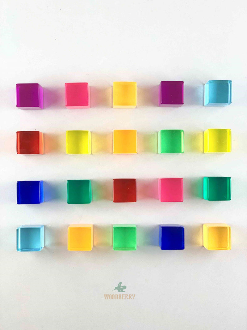 bauspiel lucite cubes passing through the light. arranged in grid