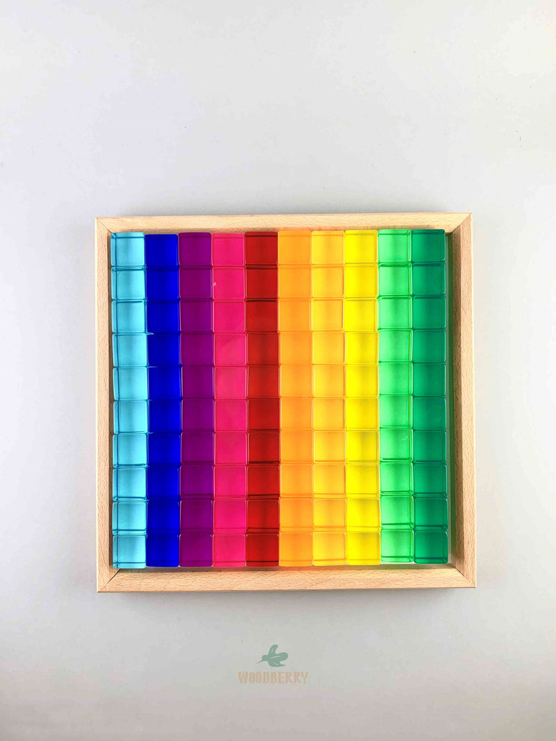 bauspiel lucite cubes in the wooden tray. 10 colors with 10 cubes each.