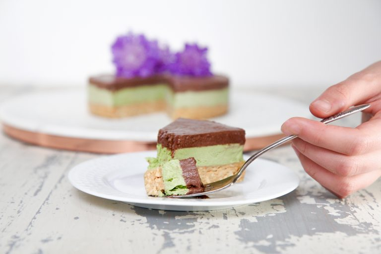 Slice of dream cake! Raw, paleo and vegan chocolate ganache tahini Mizuba Matcha Green Tea Cake. Organic and low sugar!