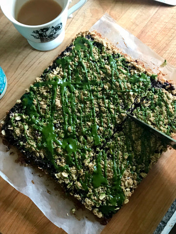 Cutting into a delicious cookie bar that's gluten free and vegan! Meet your matcha green tea dessert of choice
