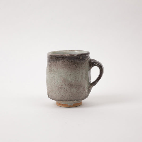 Handmade carbon ceramic mug for drinking Japanese Green Tea. Los Angeles based artist