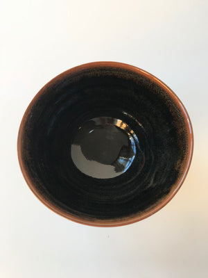 Inside look at a handmade Japanese Matcha Green Tea Black Chawan Bowl for drinking