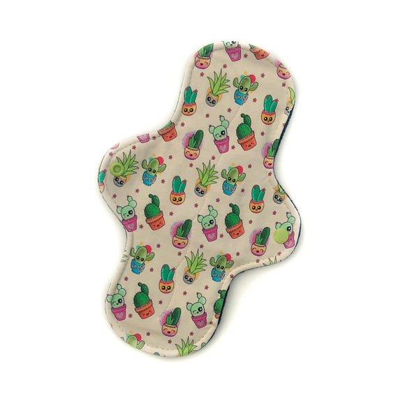 standard moderate absorbency reusable menstrual pad in a kawaii cacti print