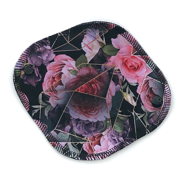 reusable mini pantyliner in a gorgeous black and pink geo floral print