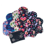 Reusable Cloth Pad Starter Kit with a variety of lengths and absorbencies and a waterproof pouch; made in Canada