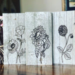 Set of engraved flowers on reclaimed barn wood