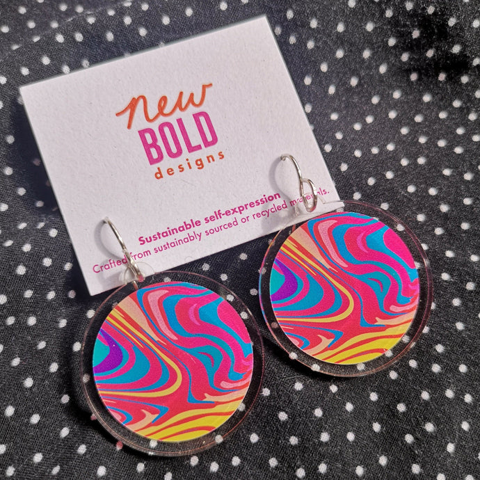 Colourful psychedelic pattern printed onto a circular recycled acrylic disk. Finished with sterling silver hooks.