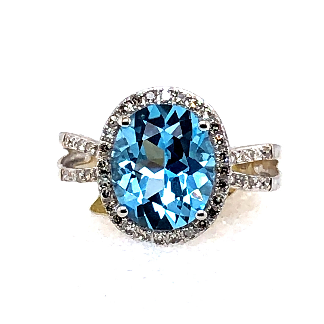 14 Karat White Gold Ring with Blue Topaz & Diamonds