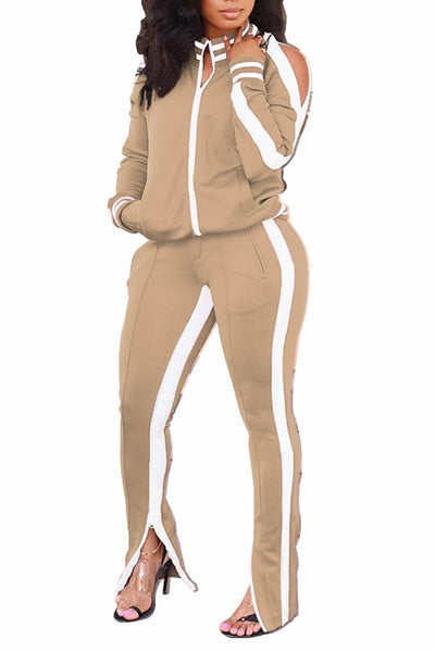 Camel two piece set with a pullover hole round neck long sleeve jacket with slits in the shoulder, long pants with a slit and solid white strip down accent piece and pockets on top and bottom
