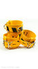 Bright yellow leather restraint set