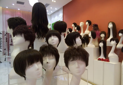 wig mannequins in a store