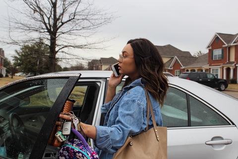busy mom wearing wig going into car