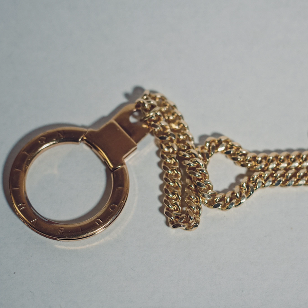 Louis Vuitton Gold Round Lock